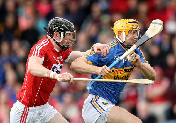 Tipperary's Seamus Callanan is tackled by Damian Cahalane. Picture: INPHO/Cathal Noonan