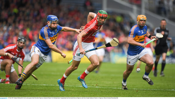 Stephen McDonnell of Cork in action against John McGrath of Tipp. Picture: Brendan Moran/Sportsfile