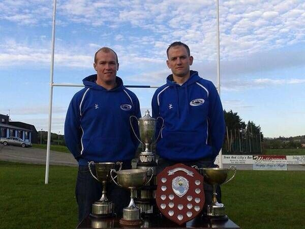 James Neville on the right pictured with Bandon RFC club captain Tim Crowley after their successful 2013-2014 season.