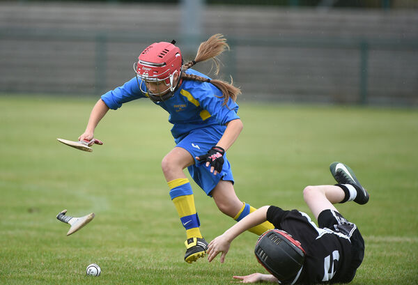 Sean Twomey, Donoughmore loses his footing in a challenge against Erin O'Brien, Bartlemy. Pic; Larry Cummins
