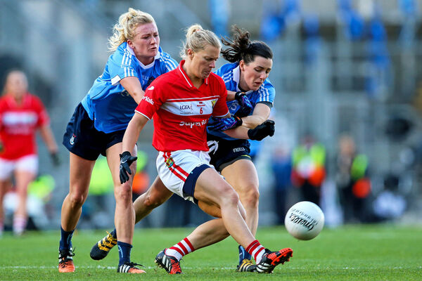 Cork's Deirdre O'Reilly, with Carla Rowe and Lyndsey Davey, of Dublin, in the 2016 All-Ireland. Picture: INPHO/Tommy Dickson