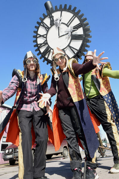 Members of CORK COMMUNITY ART LINK preparing for the parade, Jonathan Crean with Jekaterina and Anthony Rusinov have plenty of time....with the Mangan Clock.Picture; Larry Cummins