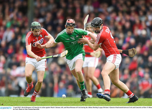 David Dempsey of Limerick in action against Mark Coleman, left, and Dean Brosnan of Cork. Photo: Eóin Noonan/Sportsfile