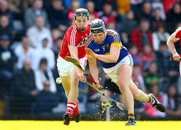 Cork's Mark Coleman and Dan McCormack of Tipperary. Picture: INPHO/Cathal Noonan