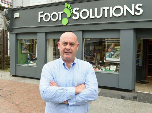 Tony Linehan outside the Cork City shoe store.Picture: Larry Cummins