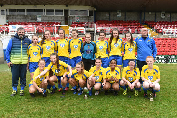 Winning U16 team Carrigaline United with managers Pat O'Brien and Steve Lambe. Picture: Larry Cummins
