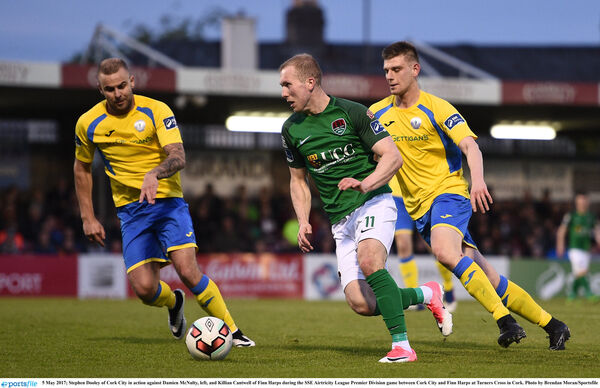 Stephen Dooley of Cork City in action against Damien McNulty, left, and Killian Cantwell of Finn Harps. Picture: Brendan Moran/Sportsfile