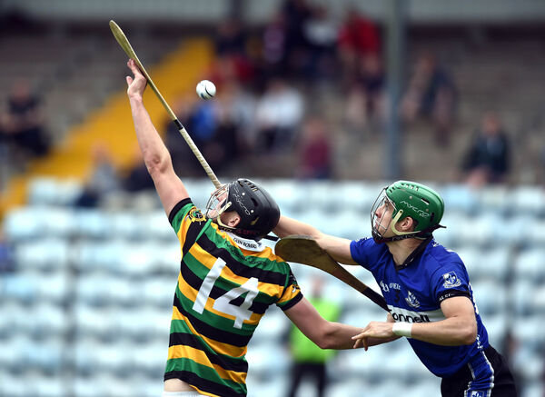 Glen Rovers' Mark Dooley and Sarsfields' Craig Leahy tussle for the ball during the Cork SHC at Páirc Uí Rinn on Sunday. Picture: Eddie O'Hare