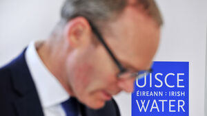 Minister Coveney defends Irish Water staff in row over €5,000 bonuses