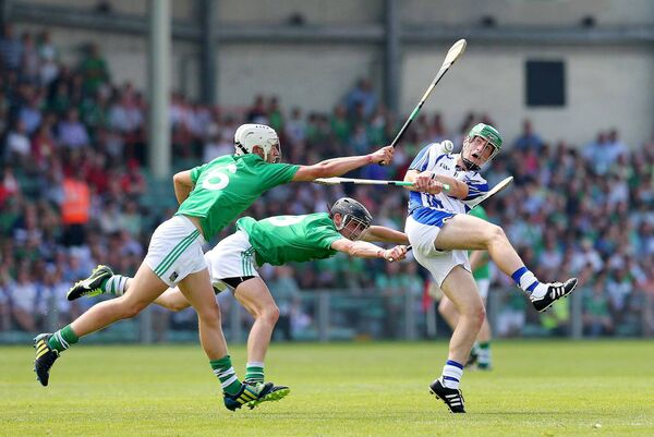 Limerick's Andrew La Touche Cosgrave and Darragh O'Donovan tackle Colm Roche of Waterford in the 2013 minor clash. Picture: INPHO/Lorraine O'Sullivan
