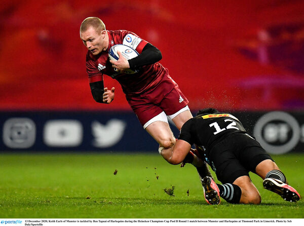 Keith Earls of Munster is tackled by Ben Tapuai of Harlequins. Picture: Seb Daly/Sportsfile