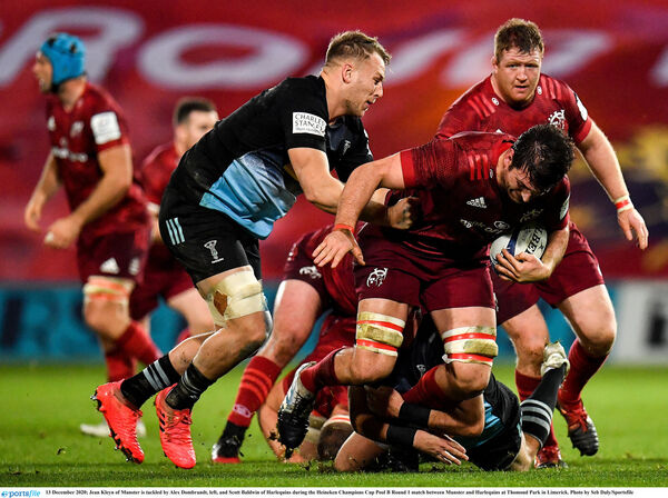 Jean Kleyn of Munster is tackled by Alex Dombrandt, left, and Scott Baldwin of Harlequins. Picture: Seb Daly/Sportsfile