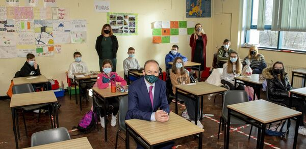 An Taoiseach, Micheál Martin, TD, sits in with pupiols at class in the Polish School, hosted in the North Monastery each weekend.