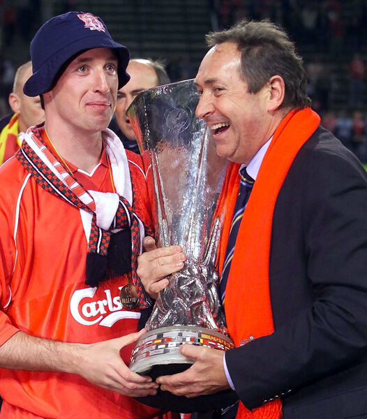 File photo dated 16-05-2001 of Liverpool manager Gerard Houllier and Robbie Fowler holds aloft the UEFA cup after his side beat Alaves of Spain 5-4 under the Golden Goal rule during the UEFA Cup Final at the Westfalen Stadium, Dortmund. PA Photo. Issue date: Monday December 14, 2020. Tributes have been paid to former Liverpool manager Gerard Houllier, who has died at the age of 73. See PA story SOCCER Houllier. Photo credit should read David Davies/PA Wire.