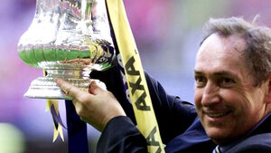 LIVERPOOL PAY TRIBUTE TO TREBLE-WINNING MANAGER GERARD HOULLIER AFTER HIS DEATH