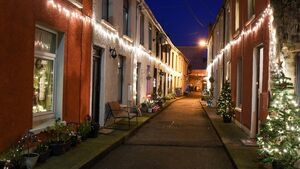 One of Cork's oldest communities lights up its street... at the end of a dark year
