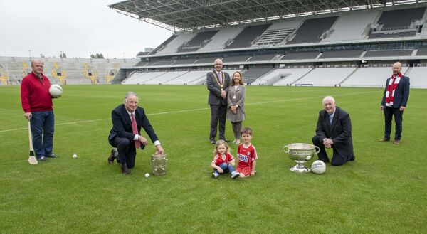 Pictured at Páirc Uí Chaoimh with the famous trophies are captains Tomás Mulcahy (hurling captain) and Larry Tompkins (football captain), Lord Mayor Cllr Joe Kavanagh and his wife Stephanie (Lady Mayoress),  Teddy McCarthy and Kevin O'Donovan, CEO, Cork GAA along with Cork fans Sean and Ciara Nolan. Picture: Brian Lougheed