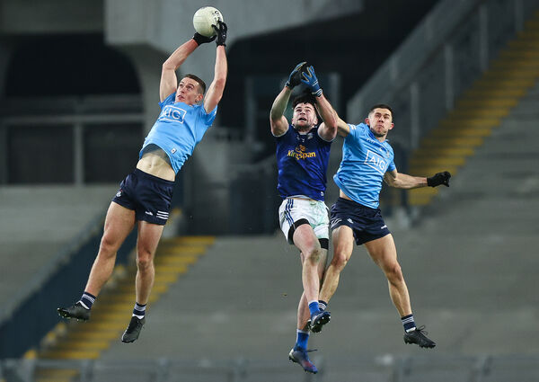 Dublin's Brian Fenton and Davy Byrne with Padraig Faulkner of Cavan. Picture: INPHO/Tommy Dickson