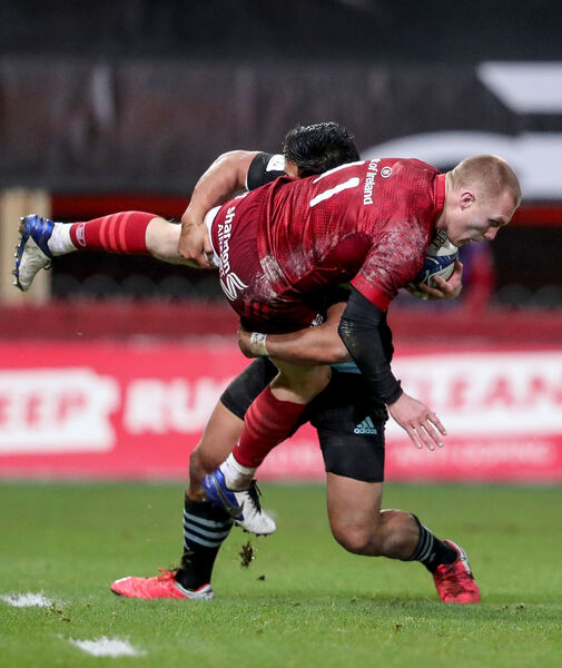 Munster's Keith Earls is tackled by Ben Tapuai of Harlequins. Picture: INPHO/Dan Sheridan