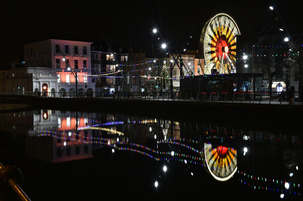 The Glow ferris wheel on the Grand Parade, Cork reflected in the River Lee at high tide. Picture: Dan Linehan