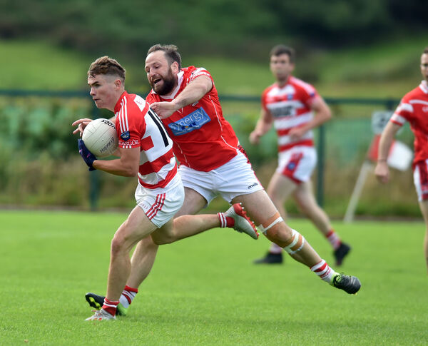 Adrigole's Seanie O'Sullivan breaks from Mayfield's Shane Fitzgerald during the Bon Secours Cork IAFC at Inchgeela. Picture: Eddie O'Hare
