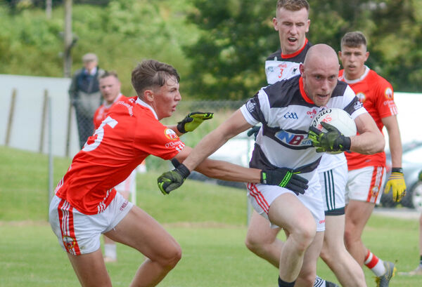 Rob McCarthy Coade, St Nicks, manages to pull away from Shane O'Driscoll, O'Donovan Rossa. Picture: Howard Crowdy