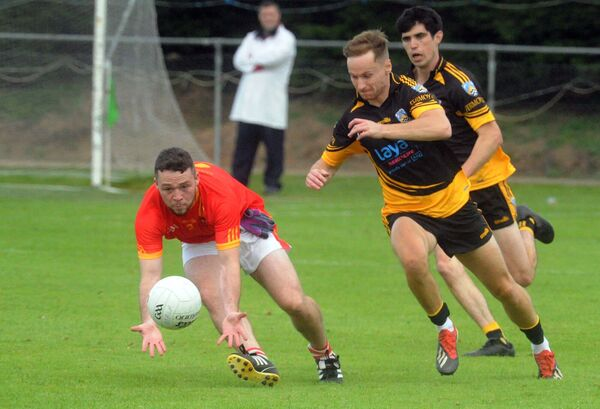 Mallow's Oisín Carroll winning the ball from Fermoy's Kieran Morrison in the Bon Secours Cork Senior A Football Championship semi-final at Glanworth. Picture Denis Minihane.