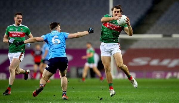 Dublin's John Small and Oisín Mullin of Mayo. Picture: INPHO/Ryan Byrne