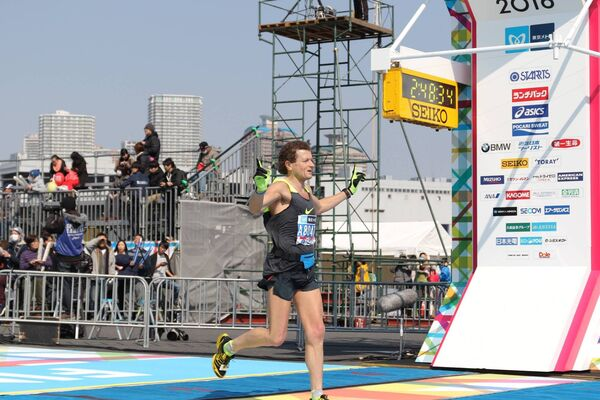 Liam Cotter crosses the line at the Tokyo Marathon. He has completed the 'Big 6' marathons around the world - finishing all of them in under 2hours 50 minutes