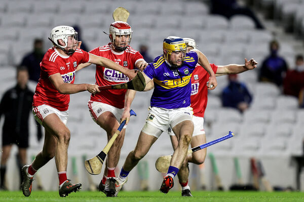 Tipperary's Conor Bowe with Eoin Roche, Daire O'Leary and Tommy O'Connell of Cork. Picture: INPHO/Laszlo Geczo