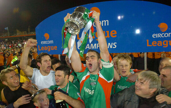 Dan Murray lifts the title in 2005 as Alan Bennett roars his approval. Picture: Larry Cummins