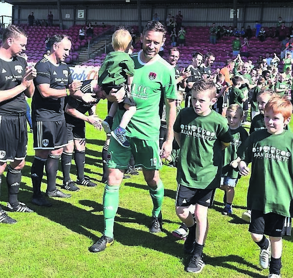 Bennett with his nieces and nephews is clapped on by Cork City legends in his testimonial at Turner's Cross.