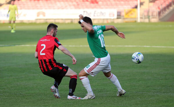 Daire O'Connor, Cork City FC, challenged by Shane Elworthy, Longford Town. Picture: Jim Coughlan.