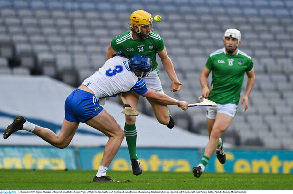 Séamus Flanagan of Limerick is tackled by Conor Prunty of Waterford. Picture: Brendan Moran/Sportsfile