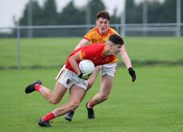 Conor McGoldrick, Éire Óg, tackles Sean McDonald, Mallow. Picture: Jim Coughlan.