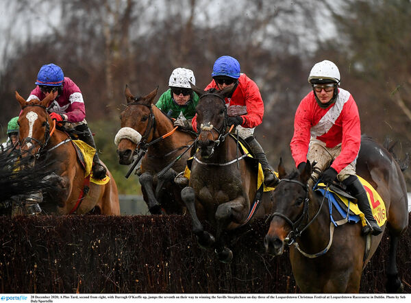 A Plus Tard, second from right, with Darragh O'Keeffe up, jumps the seventh on their way to winning. Picture: Seb Daly/Sportsfile
