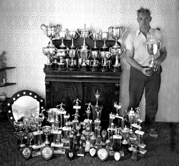 Bowlplayer Mick Barry with some of the many trophies he won during his career