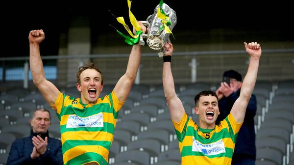 Blackrock's Michael O'Halloran and Cathal McCormack lift the trophy. Picture: INPHO/Ryan Byrne
