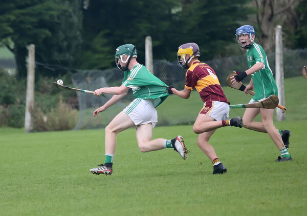 Youghal captain Marty Desmond tries to hold back Aghada's Sean O'Callaghan as James Motherway looks on. Picture: John Hennessy