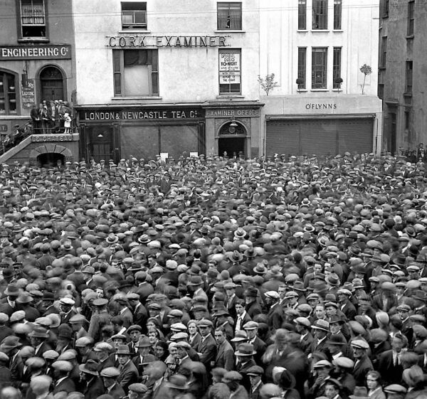 Crowds wait outside the Cork Examiner office for the result of the Jack Doyle vs Jack Petersen British heavyweight title fight which took place at White City, London, in July 1933.