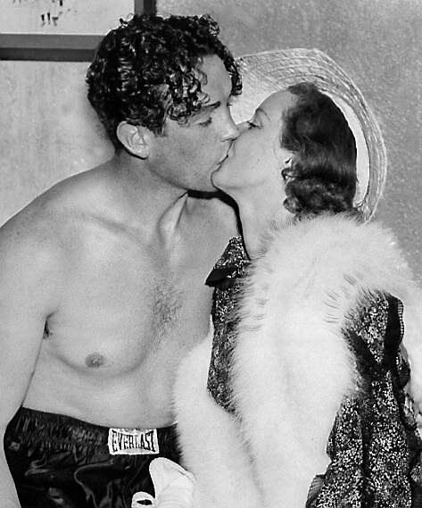 Jack Doyle gets a kiss from his wife, actress Judith Allen, after he knocked out Phil Donato at the Dyckman Oval. Picture: Charles Hoff/NY Daily News Archive via Getty Images