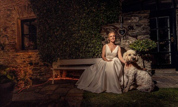 BY HER SIDE: Jennifer with their dog Dolly, who played a role in the wedding day.