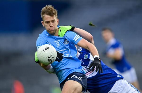Jonny Cooper of Dublin in action against Eoin Buggie of Laois. Picture: Piaras Ó Mídheach/Sportsfile