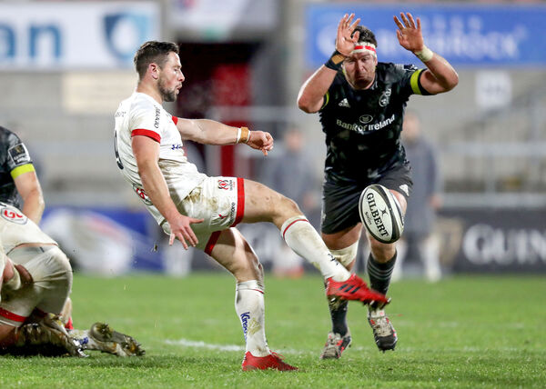 Ulster's John Cooney and Billy Holland of Munster in action. Picture: INPHO/Bryan Keane