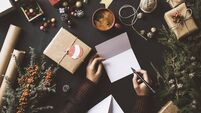 Writing New Year Christmas cards, table top flat lay