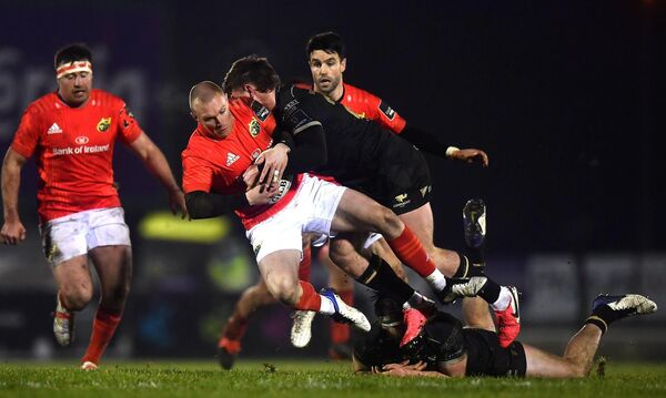 Keith Earls of Munster is tackled by Peter Sullivan of Connacht. Picture: Sam Barnes/Sportsfile