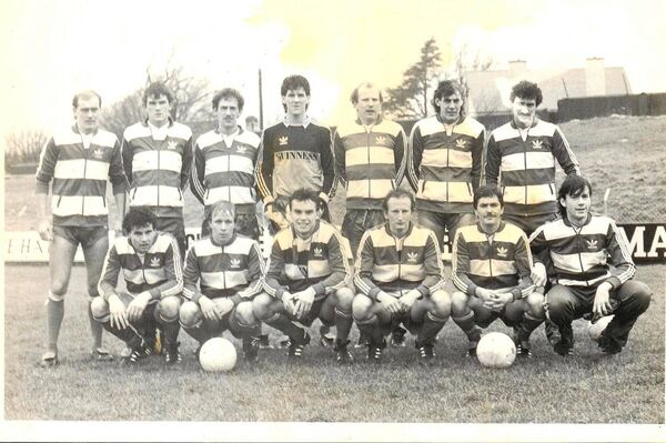 Terry McDermott Liverpool extreme right back row with Cork City in 1985. Back: Trevor Parr, Clem Mahon, Liam Keane, Ian Douglas, Donie Madden, Stuart Ashton, Terry McDermott. Front: Dave O'Connor, Pat Healy, Bobby Woodruff, Dave Waters, Paul Crowley, Ian Hennessy.
