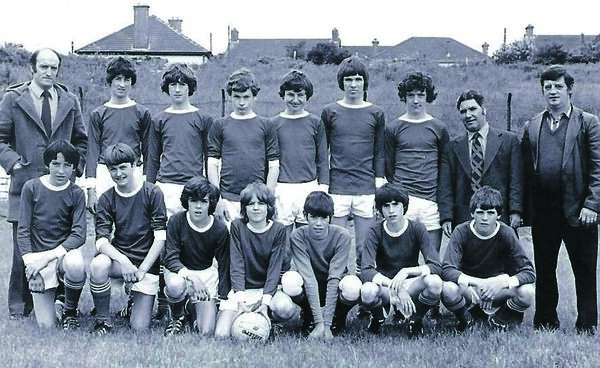Denis Irwin with Everton after their U15 league win in 1981, his last season with the Togher club before moving to Leeds United. Back row Tommy Twomey, Michael Kent, Liam McGrath, Noel O'Sullivan, Denis Irwin, Eric Bergin, John Keane, Willie Finney, David Duffy. Front row: Nial Kavanagh, Anthony O'Sullivan, Alan Twomey, Derek O'Sullivan, Eric Barrett, Stanley Notte, Noel O'Leary.
