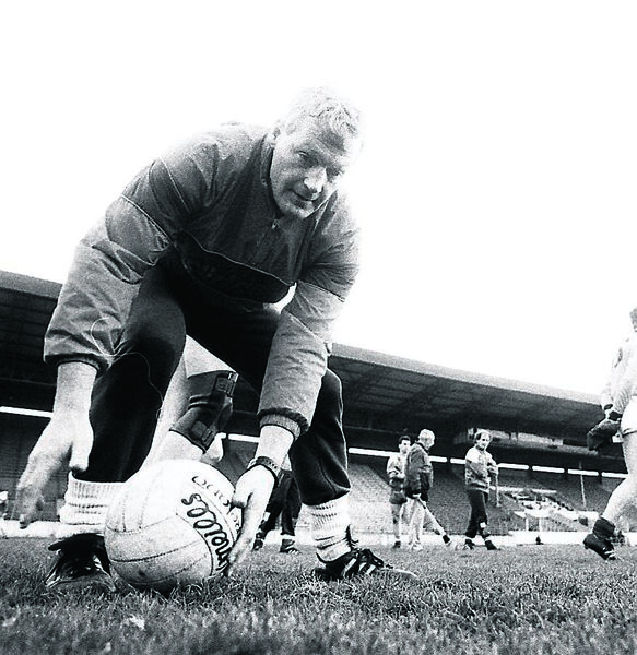 SAFE PAIR OF HANDS: Billy Morgan during a training session in April 1990.