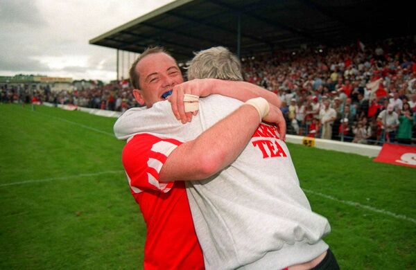 Cork captain Niall Cahalane celebrates with manager Billy Morgan following the Munster final win over Kerry in 1995 at Fitzgerald Stadium. Picture: Brendan Moran/Sportsfile
